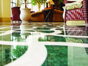 Green and white polished marble floor