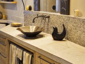 honed limestone vanity in a residential bathroom