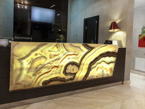 polished onyx hotel reception desk